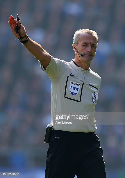 Referee Martin Atkinson gestures during the Barclays Premier League match between Everton and Liverpool at Goodison Park on October 4 2015 in...