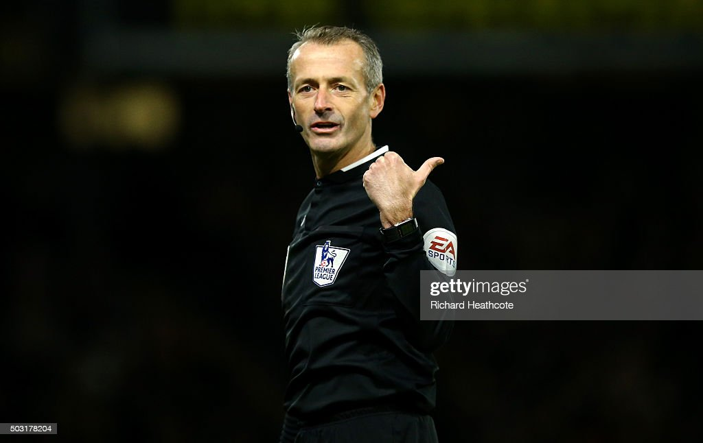 Referee, <a gi-track='captionPersonalityLinkClicked' href=/galleries/search?phrase=Martin+Atkinson&family=editorial&specificpeople=703318 ng-click='$event.stopPropagation()'>Martin Atkinson</a> gestures during the Barclays Premier League match between Watford and Manchester City at Vicarage Road on January 2, 2016 in Watford, England.