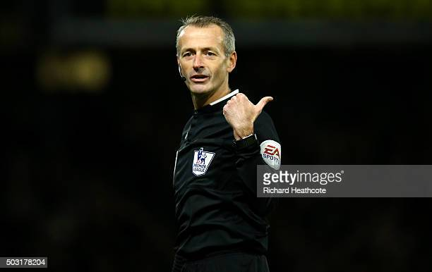 Referee Martin Atkinson gestures during the Barclays Premier League match between Watford and Manchester City at Vicarage Road on January 2 2016 in...