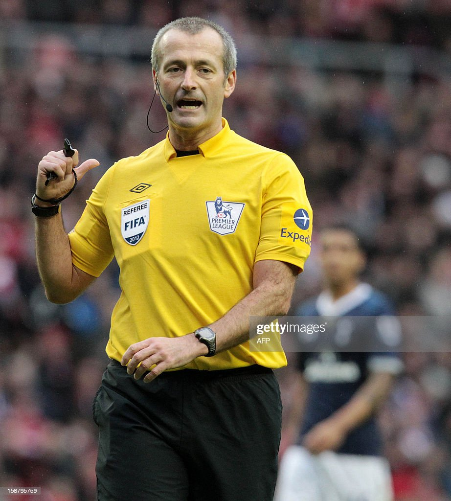 "Referee Martin Atkinson gestures during the English Premier League football match between Sunderland and Tottenham Hotspur at The Stadium of Light in Sunderland, north-east England on December 29, 2012. Tottenham Hotspur won the game 2-1. USE. No use with unauthorized audio, video, data, fixture lists, club/league logos or ""live"" services. Online in-match use limited to 45 images, no video emulation. No use in betting, games or single club/league/player publications."