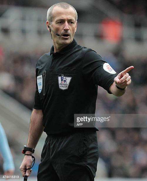 Referee Martin Atkinson gestures during the English Premier League football match between Newcastle United and Aston Villa at St James' Park in...
