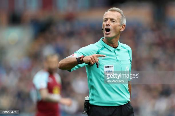 Referee Martin Atkinson gestures during the Premier League match between Burnley and West Bromwich Albion at Turf Moor on August 19 2017 in Burnley...