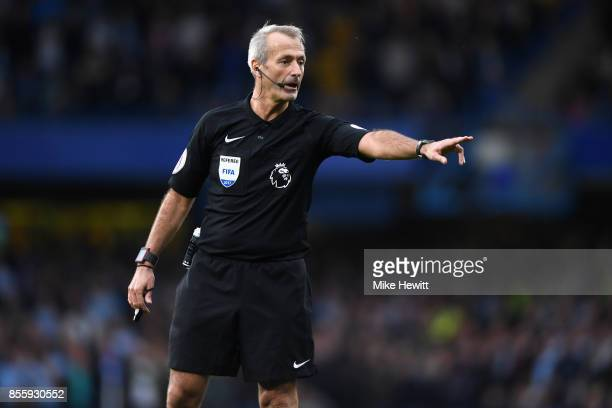 Referee Martin Atkinson gestures during the Premier League match between Chelsea and Manchester City at Stamford Bridge on September 30 2017 in...