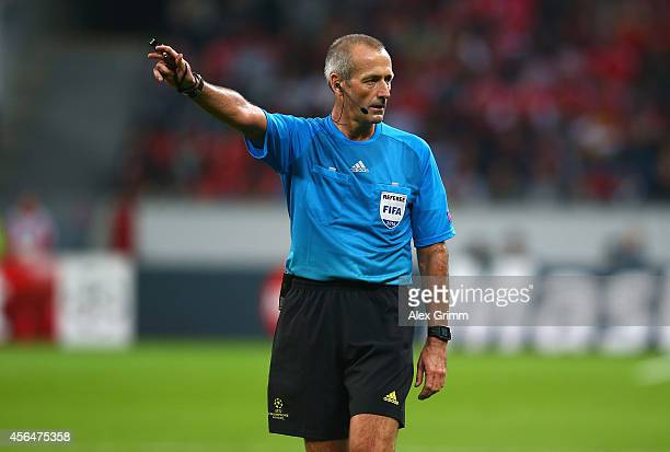 Referee Martin Atkinson gestures during the UEFA Champions League Group C match between Bayer 04 Leverkusen and SL Benfica on October 1 2014 in...