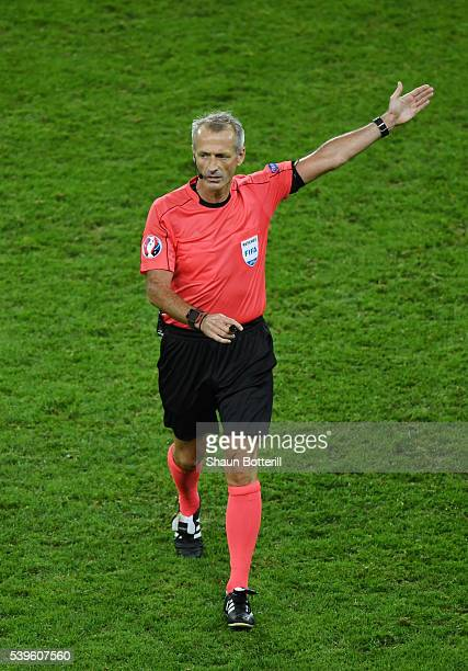 Referee Martin Atkinson gestures during the UEFA EURO 2016 Group C match between Germany and Ukraine at Stade PierreMauroy on June 12 2016 in Lille...