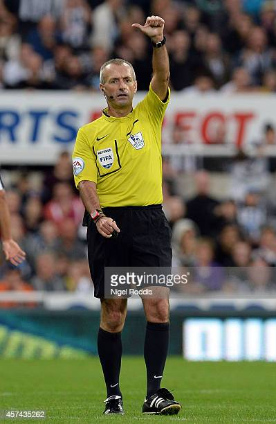 Referee Martin Atkinson gives a decision during the Barclays Premier League match between Newcastle United and Leicester City at St James' Park on...