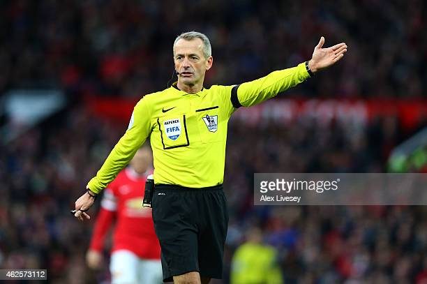 Referee Martin Atkinson gives a decision during the Barclays Premier League match between Manchester United and Leicester City at Old Trafford on...