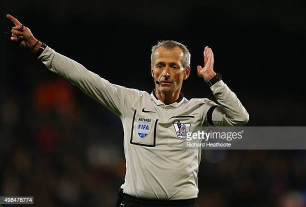 Referee Martin Atkinson gives a decision during the Barclays Premier League match between Crystal Palace and Sunderland at Selhurst Park on November...