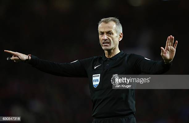 Referee Martin Atkinson gives a decision during the Premier League match between Manchester United and Sunderland at Old Trafford on December 26 2016...