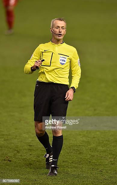 Referee Martin Atkinson in action during The Emirates FA Cup Fourth Round between Liverpool and West Ham United at Anfield on January 30 2016 in...