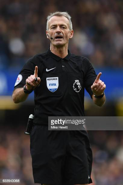 Referee Martin Atkinson in action during the Premier League match between Chelsea and Arsenal at Stamford Bridge on February 4 2017 in London England