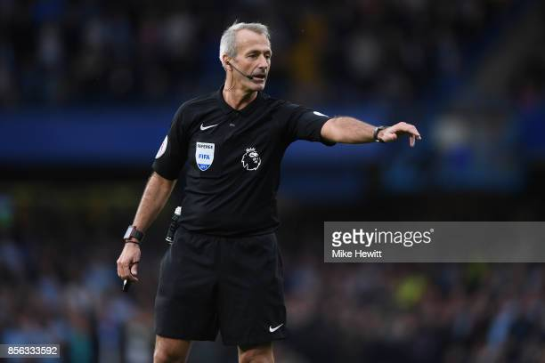 Referee Martin Atkinson in action during the Premier League match between Chelsea and Manchester City at Stamford Bridge on September 30 2017 in...