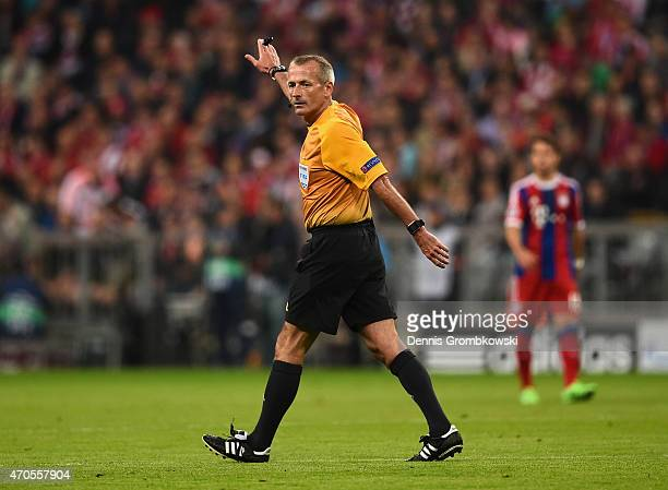 Referee Martin Atkinson in action during the UEFA Champions League Quarter Final Second Leg match between FC Bayern Muenchen and FC Porto at Allianz...