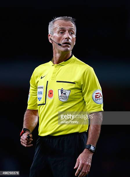 Referee Martin Atkinson looks on during the Barclays Premier League match between Arsenal and Tottenham Hotspur at the Emirates Stadium on November 8...