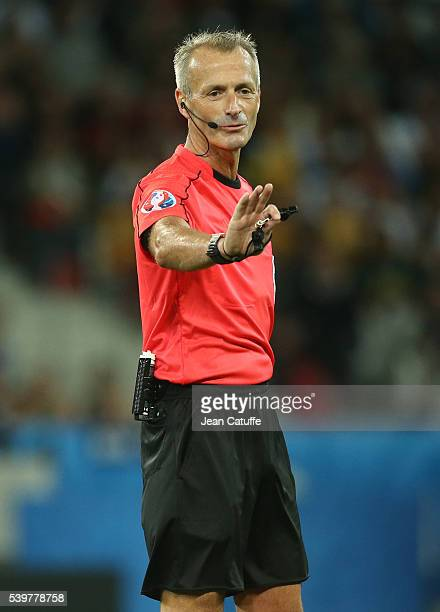 Referee Martin Atkinson of England gestures during the UEFA Euro 2016 Group C match between Germany and Ukraine at Stade Pierre Mauroy on June 12...