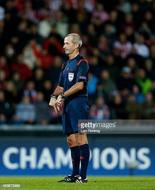 Referee Martin Atkinson of England gives instructions during the UEFA Champions League Qualifying PlayOffs Round First Leg match between AaB Aalborg...