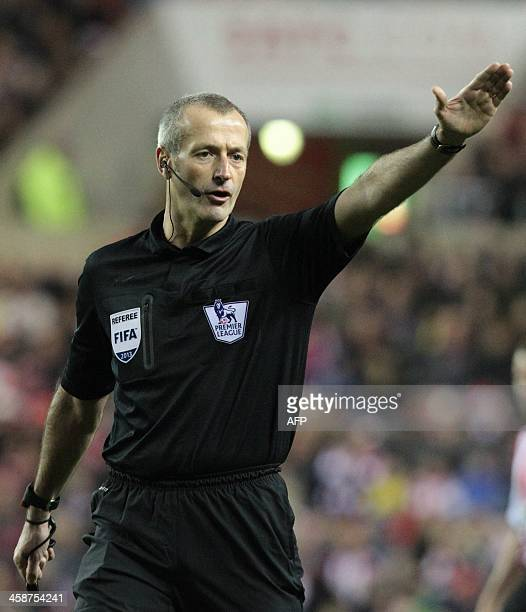 Referee Martin Atkinson officiates during the English Premier League football match between Sunderland and Norwich City at The Stadium of Light in...