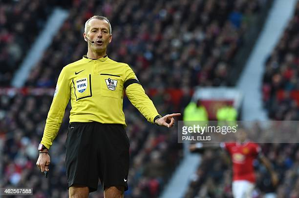 Referee Martin Atkinson officiates during the English Premier League football match between Manchester United and Leicester City at Old Trafford in...