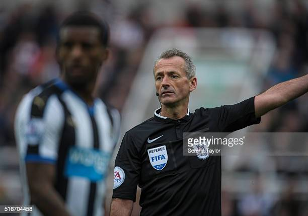 Referee Martin Atkinson points during the Premier League match between Newcastle United and Sunderland at StJames' Park on March 20 in Newcastle upon...