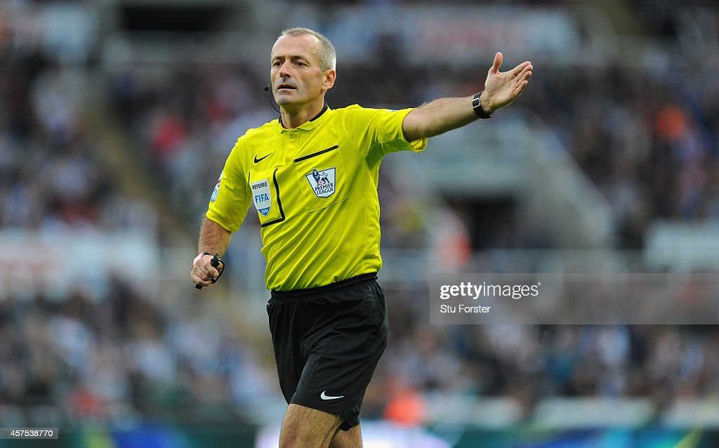 Referee <a gi-track='captionPersonalityLinkClicked' href=/galleries/search?phrase=Martin+Atkinson&family=editorial&specificpeople=703318 ng-click='$event.stopPropagation()'>Martin Atkinson</a> reacts during the Barclays Premier League match between Newcastle United and Leicester City at St James' Park on October 18, 2014 in Newcastle upon Tyne, England.