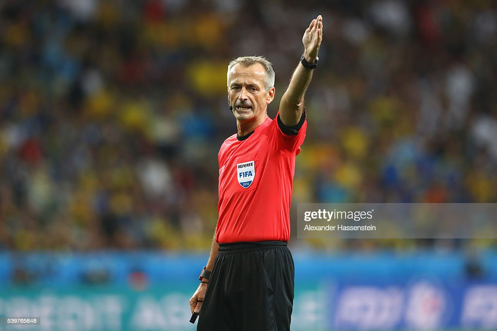 Referee <a gi-track='captionPersonalityLinkClicked' href=/galleries/search?phrase=Martin+Atkinson&family=editorial&specificpeople=703318 ng-click='$event.stopPropagation()'>Martin Atkinson</a> reacts during the UEFA EURO 2016 Group C match between Germany and Ukraine at Stade Pierre-Mauroy on June 12, 2016 in Lille, France.