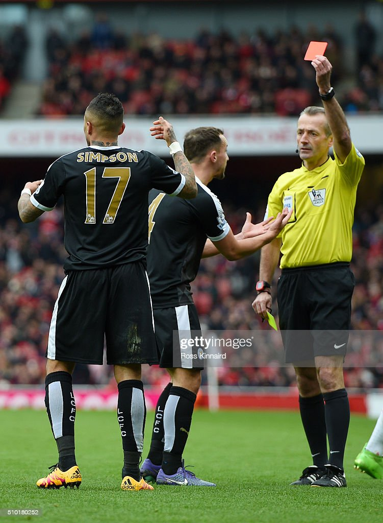 Referee Martin Atkinson shows a red card to Danny Simpson of Leicester City during the Barclays Premier League match between Arsenal and Leicester City at Emirates Stadium on February 14, 2016 in London, England.