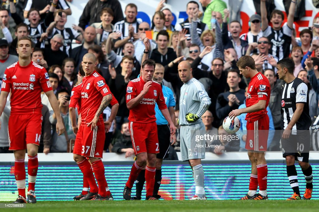 Referee Martin Atkinson shows a red card to Pepe Reina of Liverpool during the Barclays Premier League match between Newcastle United and Liverpool at Sports Direct Arena on April 1, 2012 in Newcastle upon Tyne, England.