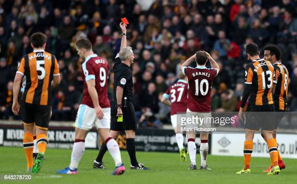 Referee Martin Atkinson shows Ashley Barnes of Burnley a red card during the Premier League match between Hull City and Burnley at KCOM Stadium on...