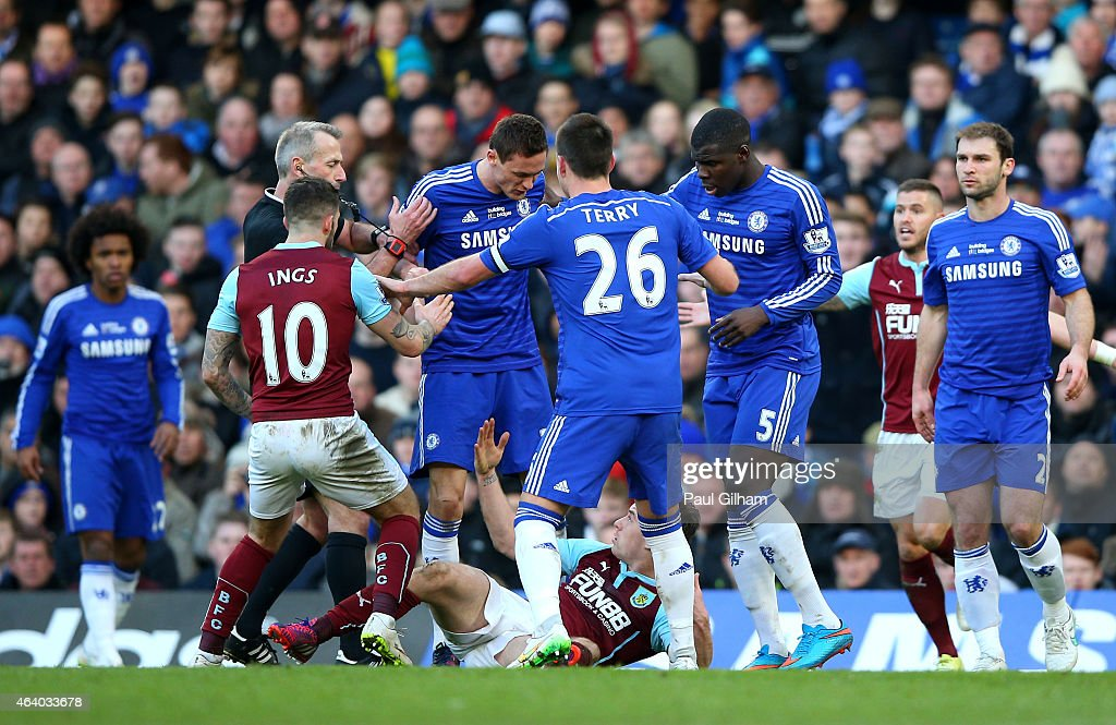 Referee Martin Atkinson shows the red card to Nemanja Matic of Chelsea for his reaction to the tackle by Ashley Barnes of Burnley during the Barclays Premier League match between Chelsea and Burnley at Stamford Bridge on February 21, 2015 in London, England.