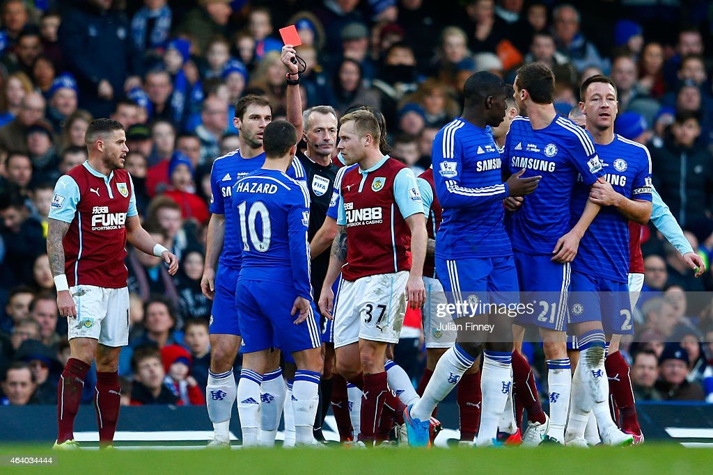 Referee <a gi-track='captionPersonalityLinkClicked' href=/galleries/search?phrase=Martin+Atkinson&family=editorial&specificpeople=703318 ng-click='$event.stopPropagation()'>Martin Atkinson</a> shows the red card to Nemanja Matic of Chelsea for his reaction to the tackle by <a gi-track='captionPersonalityLinkClicked' href=/galleries/search?phrase=Ashley+Barnes&family=editorial&specificpeople=7461176 ng-click='$event.stopPropagation()'>Ashley Barnes</a> of Burnley during the Barclays Premier League match between Chelsea and Burnley at Stamford Bridge on February 21, 2015 in London, England.