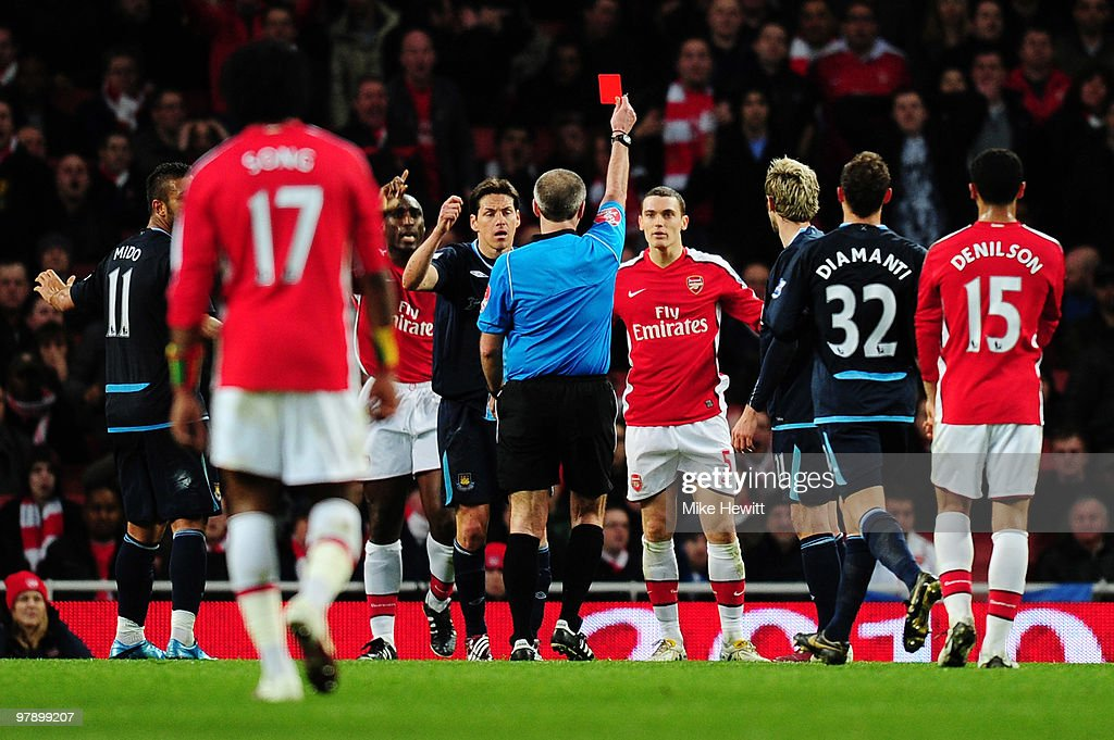 referee Martin Atkinson shows <a gi-track='captionPersonalityLinkClicked' href=/galleries/search?phrase=Thomas+Vermaelen&family=editorial&specificpeople=1360240 ng-click='$event.stopPropagation()'>Thomas Vermaelen</a> of Arsenal the red card during the Barclays Premier League match between Arsenal and West Ham United at Emirates Stadium on March 20, 2010 in London, England.