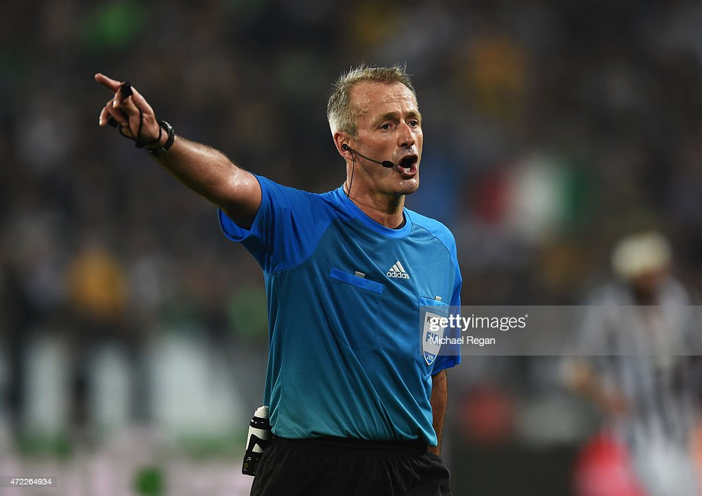 Referee Martin Atkinson signals during the UEFA Champions League semi final first leg match between Juventus and Real Madrid CF at Juventus Arena on...