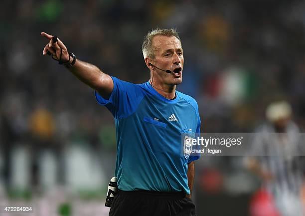 Referee Martin Atkinson signals during the UEFA Champions League semi final first leg match between Juventus and Real Madrid CF at Juventus Arena on...
