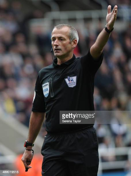 Referee Martin Atkinson signals for a corner kick during the Barclays Premier League match between Newcastle United and Cardiff City at St James'...