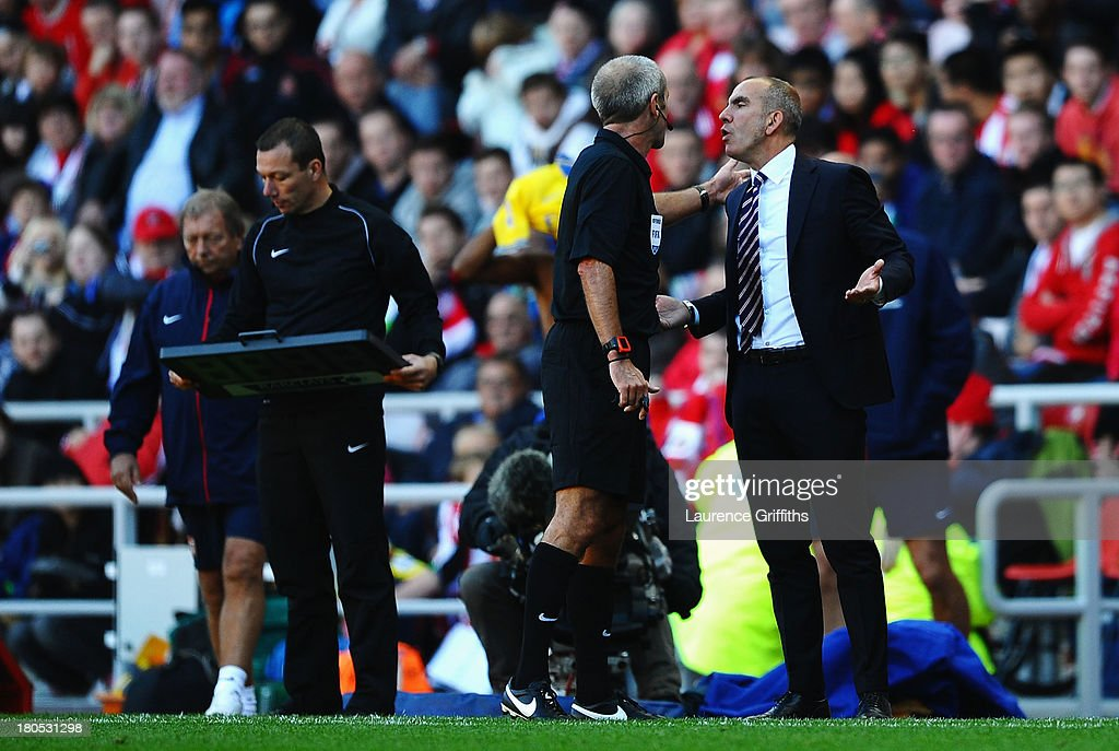 Referee Martin Atkinson speaks to Sunderland manager Paolo Di Canio during the Barclays Premier League match between Sunderland and Arsenal at the Stadium of Light on September 14, 2013 in Sunderland, England.