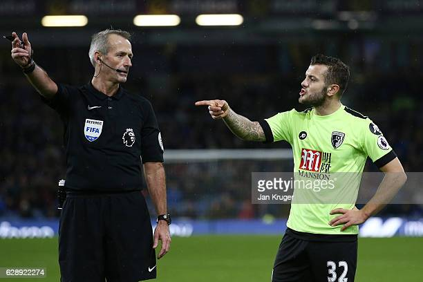 Referee Martin Atkinson speaks with Jack Wilshere of AFC Bournemouth during the Premier League match between Burnley and AFC Bournemouth at Turf Moor...