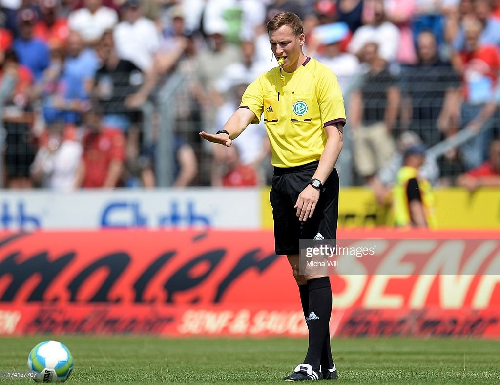 Referee Martin Petersen issues an instruction during the 3. Liga match between Jahn Regensburg and SpVgg Unterhaching at Jahnstadion on July 20, 2013 in Regensburg, Germany.