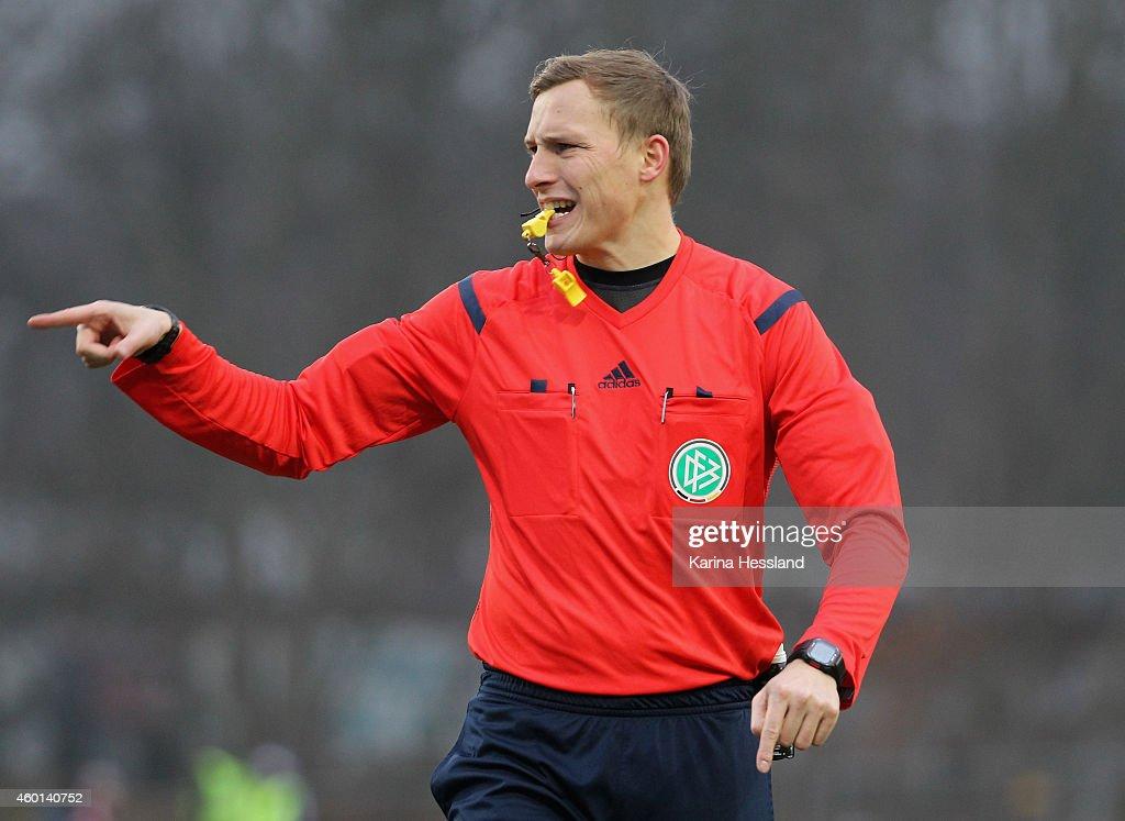 Referee Martin Petersen reacts during the 3Liga match between Chemnitzer FC and Hallescher FC at Stadion an der Gellertstrasse on Dezember 06 2014 in...