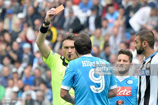Referee Massimilian Irrati shows yellow card to Gonzalo Higuain of Napoli during the Serie A match between Udinese Calcio and SSC Napoli at Stadio...