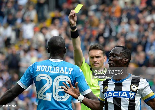 Referee Massimilian Irrati shows yellow card to Kalido Koulibaly of Napoli during the Serie A match between Udinese Calcio and SSC Napoli at Stadio...