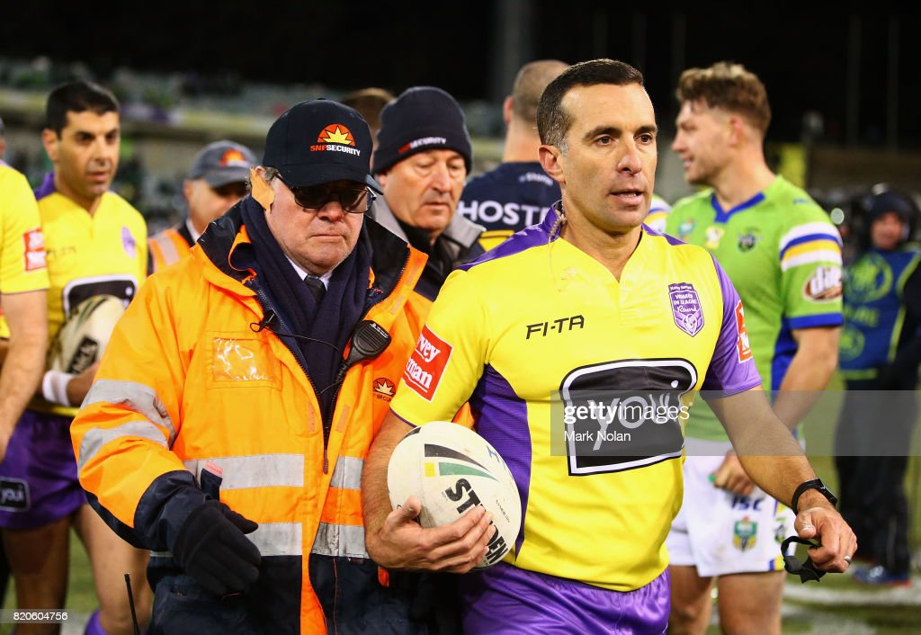 Referee Matt Cecchin is escorted from the field during the round 20 NRL match between the Canberra Raiders and the Melbourne Storm at GIO Stadium on July 22, 2017 in Canberra, Australia.