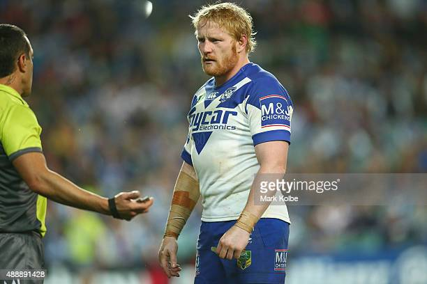 Referee Matt Cechin speaks to James Graham of the Bulldogs during the First NRL Semi Final match between the Sydney Roosters and the Canterbury...