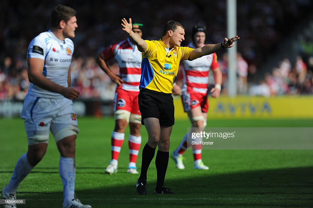 Referee Matthew Carley makes a decision during the Aviva Premiership match between Gloucester and Exeter Chiefs at Kingsholm Stadium on October 6, 2013 in Gloucester, England.