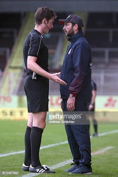 Referee Matthias Joellenbeck and Coach Sandro Schwarz of FSV Mainz 05 II during the Third League match between 1FSV Mainz 05 II and RW Erfurt at...