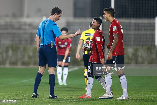 Referee Matthias Joellenbeck with Leonardo Bittencourt and Joselu during a friendly match between Young Boys Bern and Hannover 96 on January 17 2015...