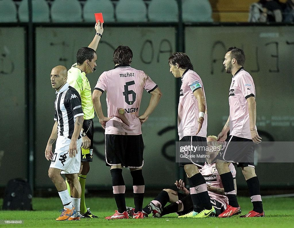 Referee Maurizio Ciampi shows the red card to <a gi-track='captionPersonalityLinkClicked' href=/galleries/search?phrase=Michel+Morganella&family=editorial&specificpeople=2484261 ng-click='$event.stopPropagation()'>Michel Morganella</a> (2nd R) during the Serie B match between AC Siena and US Citta di Palermo at Artemio Franchi - Mps Arena on October 21, 2013 in Siena, Italy.