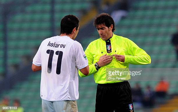 Referee Mauro Bergonzi shows a yellow card to Aleksandar Kolarov of Lazio during the Serie A match between Udinese and Lazio at Stadio Friuli on...