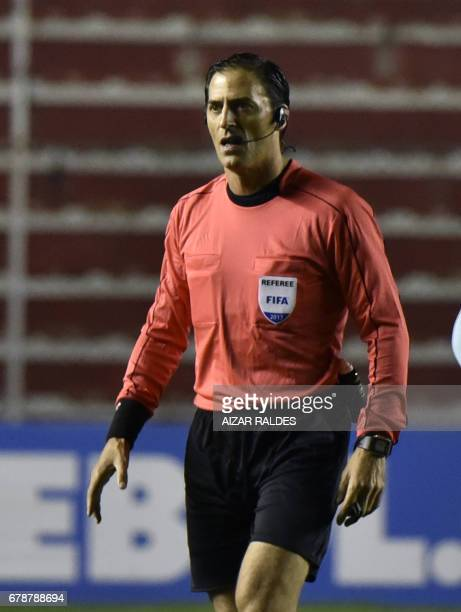 Referee Mauro Vigliano gestures during the Copa Libertadores football match between The Strongest of Bolivia and Peruvian Sporting Cristal at...