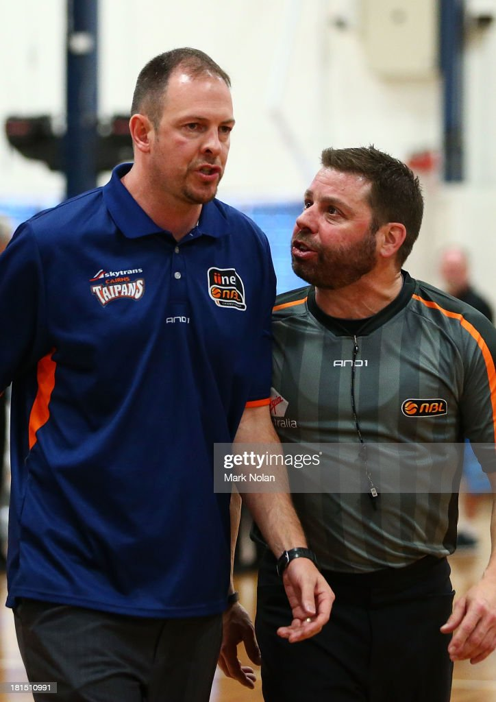 Referee Michael Aylen has heated words with Taipans coach Aaron Fearne during the 2013/14 Pre-season Blitz match between The Sydney Kings and the Cairns Taipans at the North Sydney Indoor Sports Centre on September 22, 2013 in Sydney, Australia.