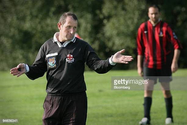 Referee Michael Blatchford from Romford gestures during a Sunday League football match on Hackney Marshes east London Sunday October 8 2006 With...